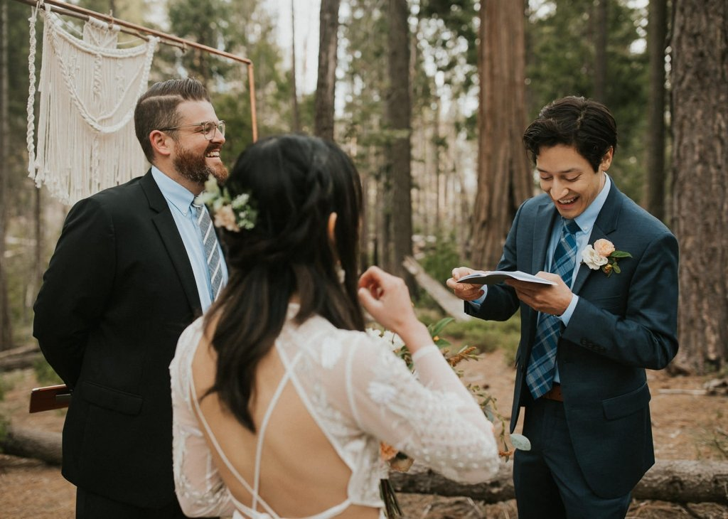 groom reading vows during ceremony