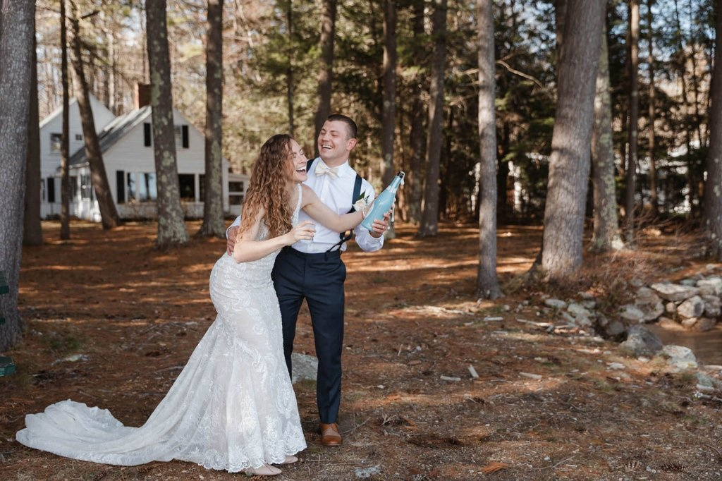 popping champagne at backyard elopement