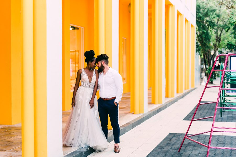 Mixed couple celebrates their urban elopement in the bold colors of Miami's Design District