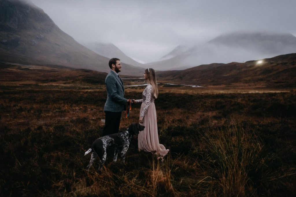 couple celebrating their engagement in Glencoe with their adorable dog.