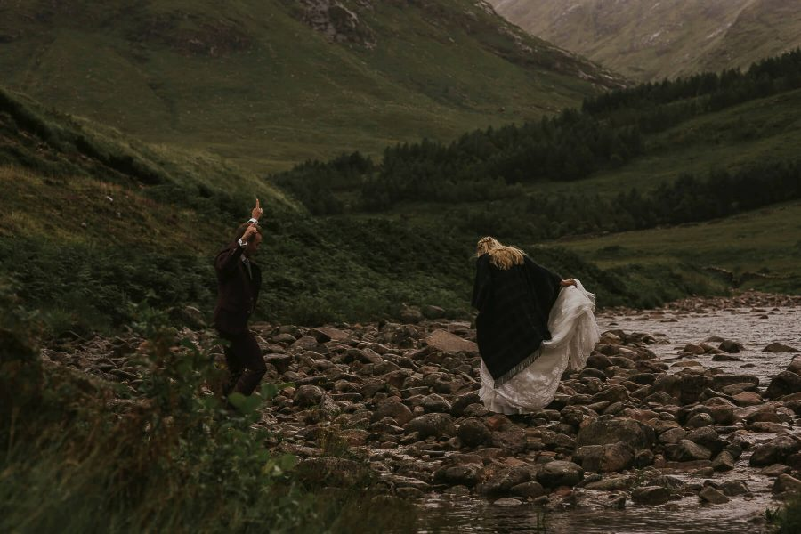 Just married and dancing in the rain - Scottish Highlands