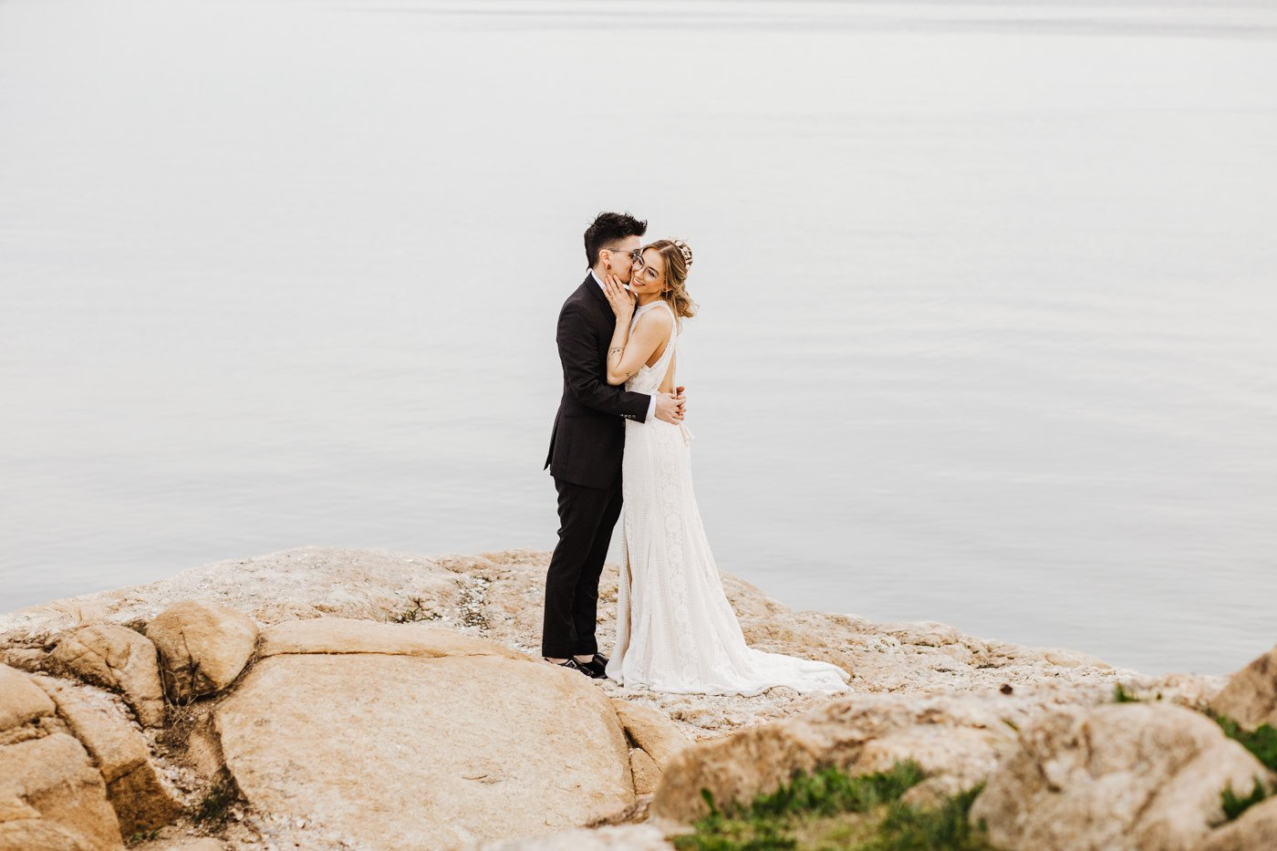 New England elopement, couple embracing during Connecticut elopement photos near the shoreline