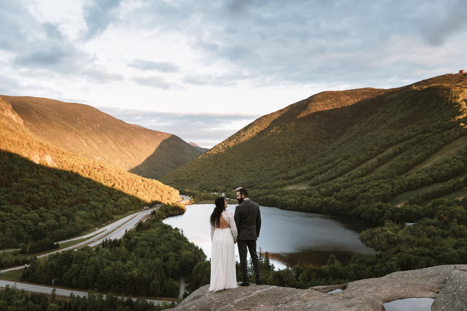 white mountains new hampshire elopement adventure with bride and groom overlooking mountain pass