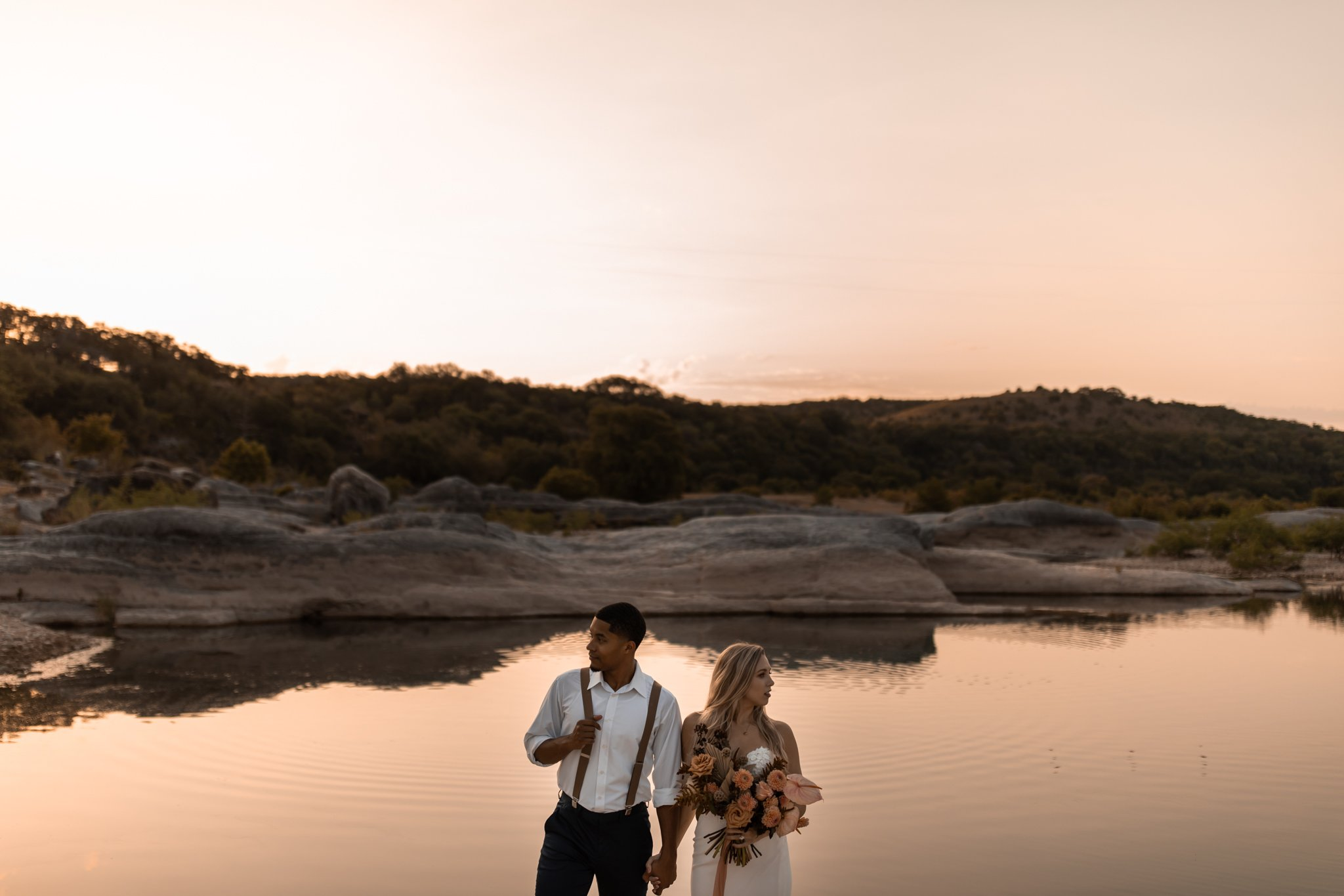 bride and groom at Pedernales Falls State Park in Texas during wedding