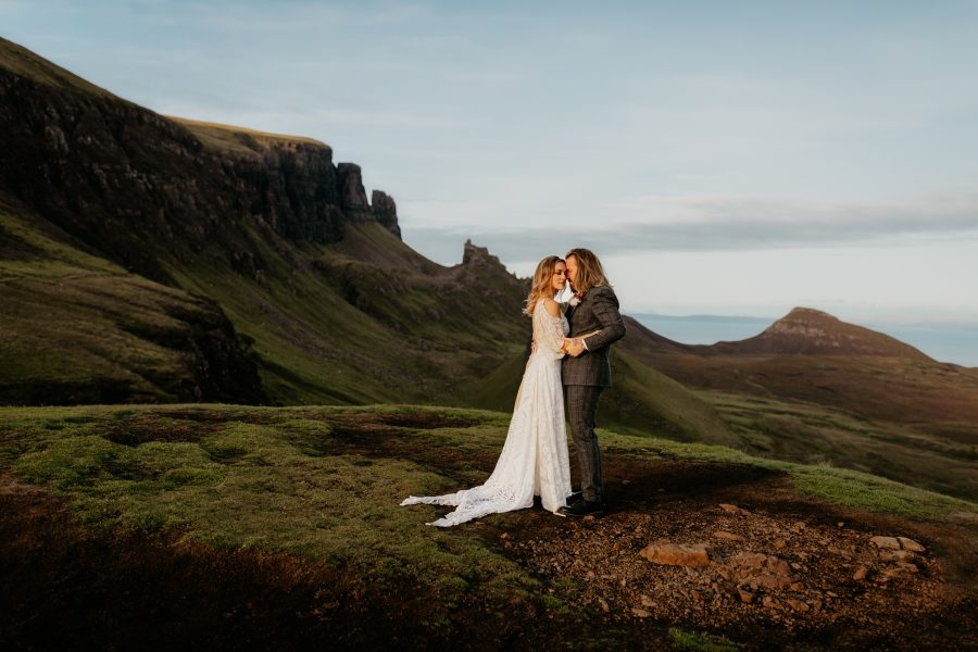 Bride and groom hold hands at the Quiraing Isle of Skye