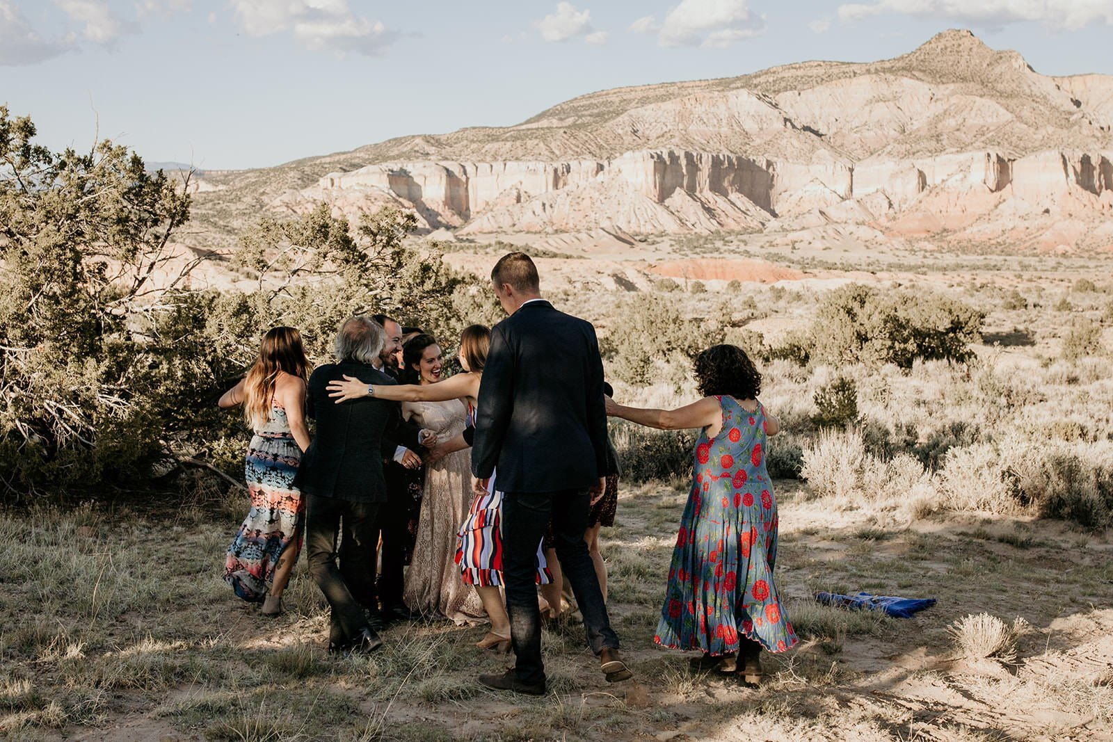 family running up to bride and groom after elopement ceremony