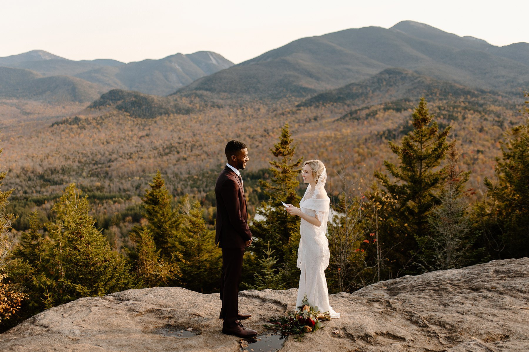 lake placid elopement ceremony with bride and groom overlooking new york mountain view
