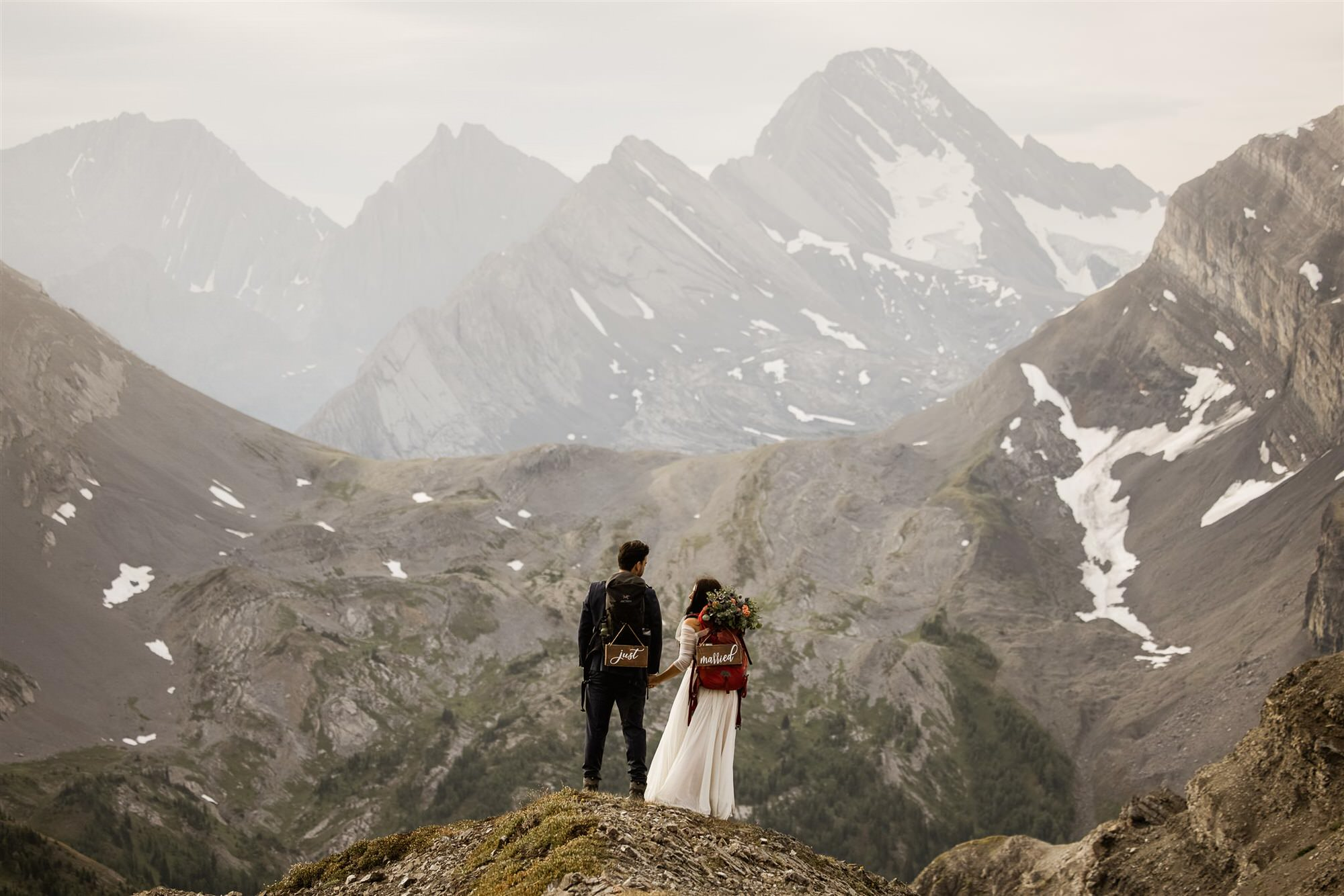 eloping in Banff Alberta. Couple hiking the canadian rockies together
