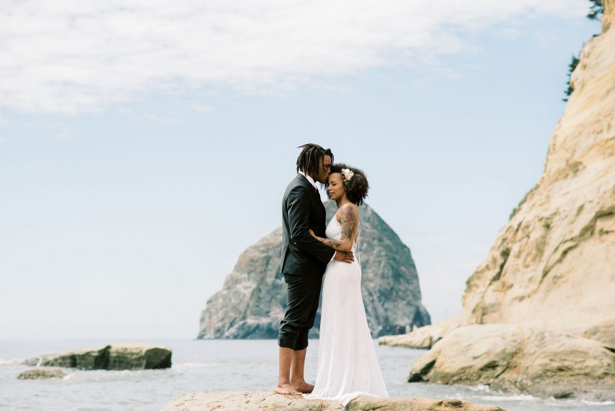 Chelsea and Aaron's elopement at beautiful Cape Kiwanda.  Photo by: Lauryn Kay Photography