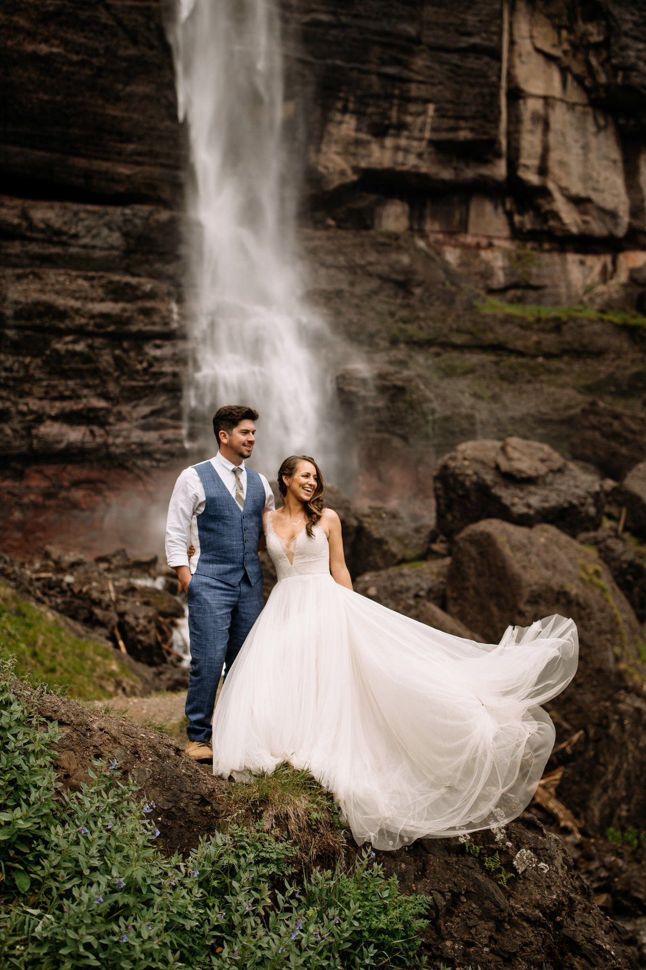 couple in front of waterfall near Telluride, CO