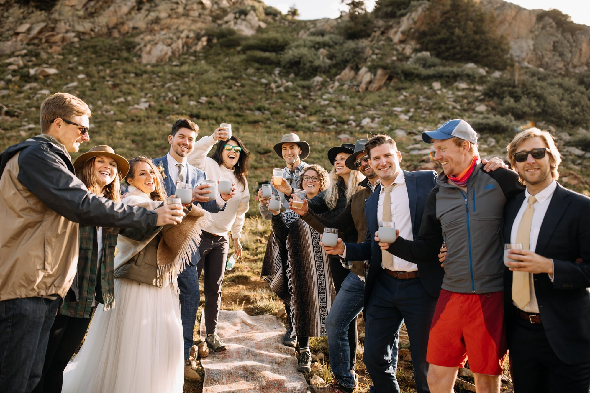 bride and groom sharing a picnic with family and friends after wedding ceremony in Telluride