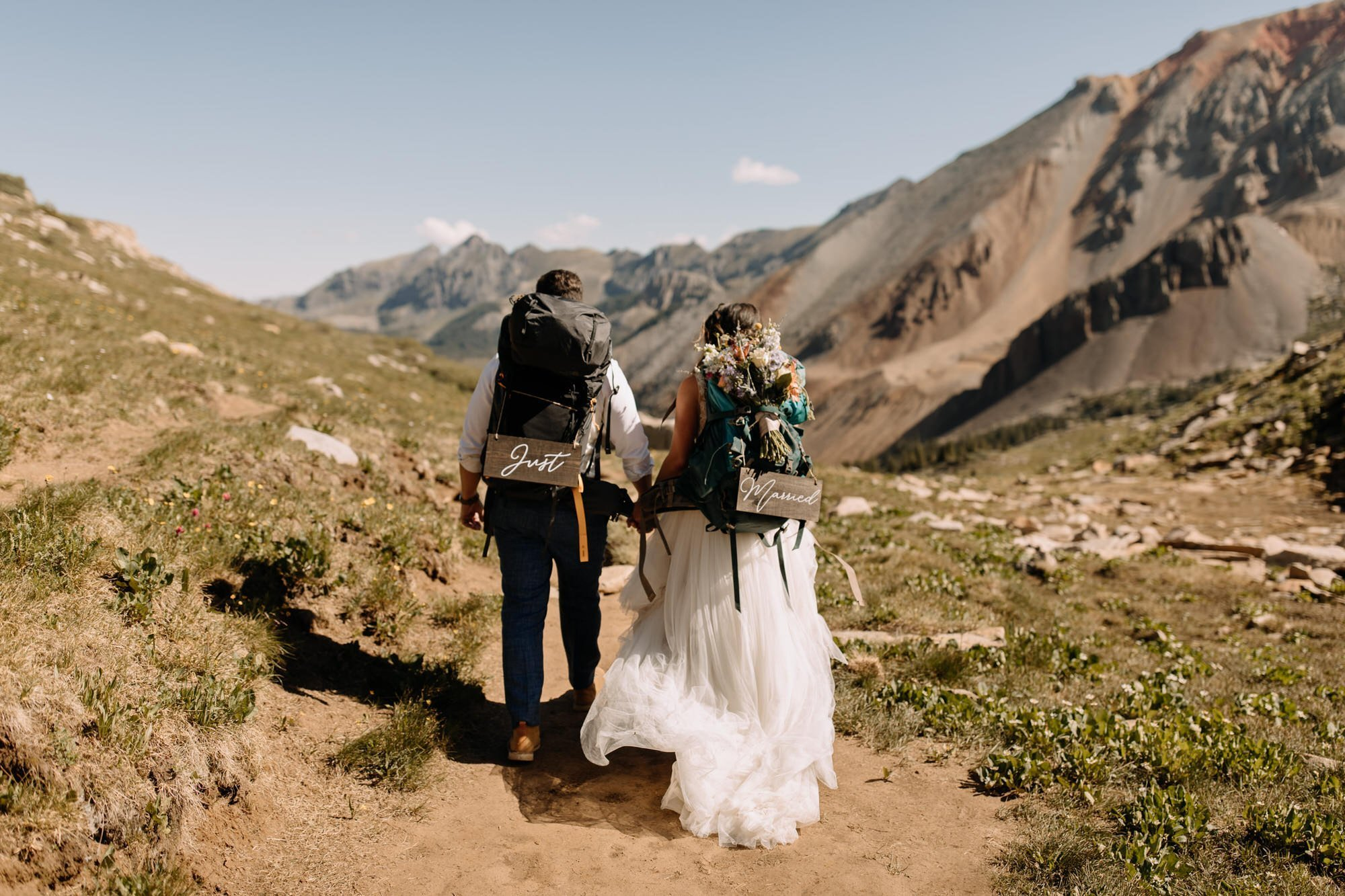 just married elopement signs during Telluride elopement hike