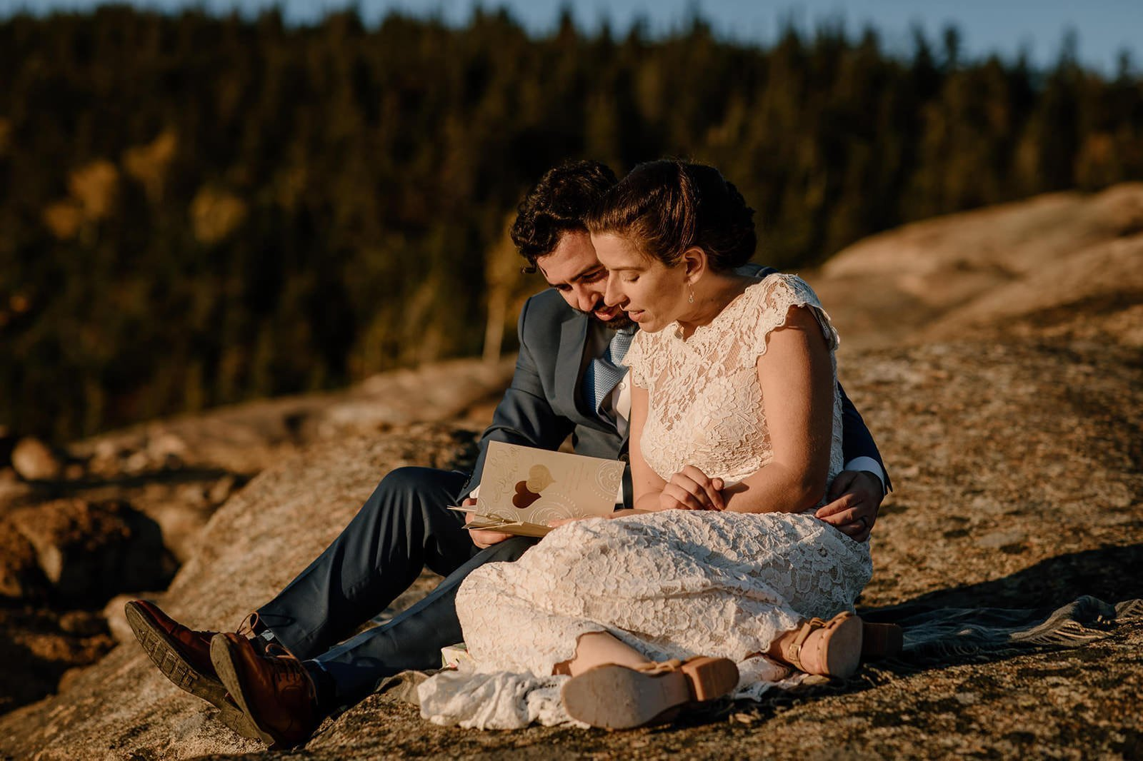 couple reading letters from family on the white mountains of NH
